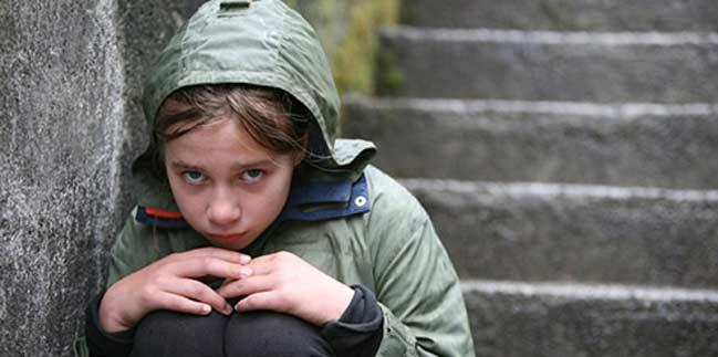 Sad child on steps