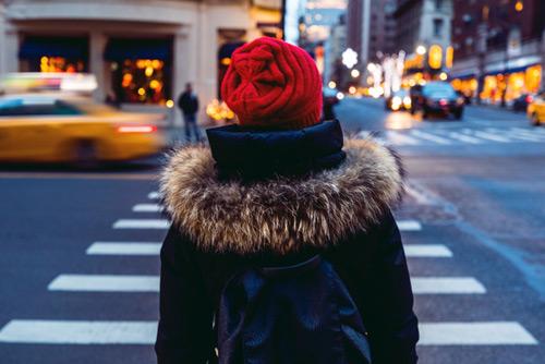 Woman walking across road in crosswalk